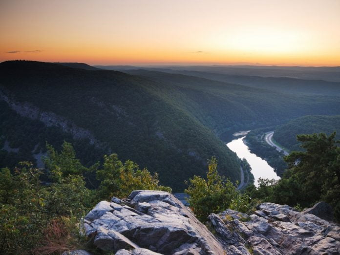 Sunset at mountain peak with river and mountain outlines from Delaware Water Gap, Pennsylvania.