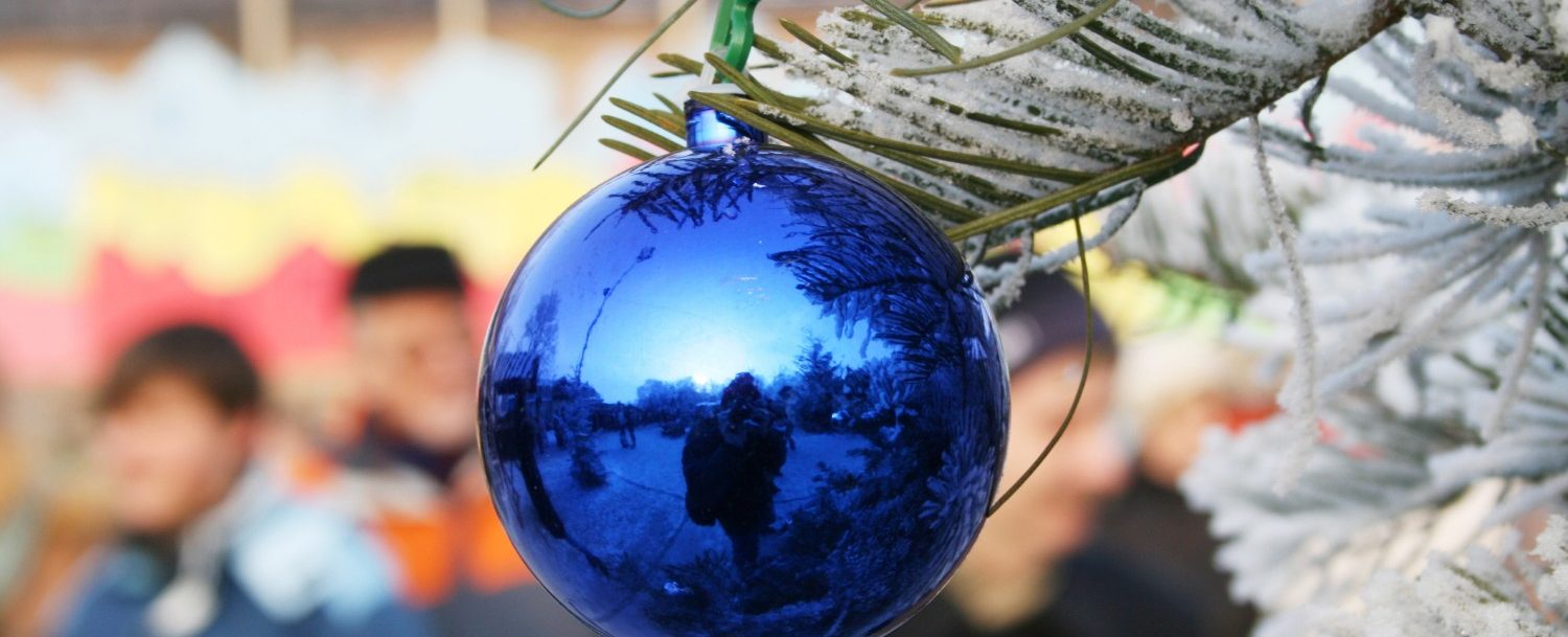 winter festival, picture of blue metallic ornament on outdoor christmas tree