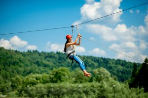 Riding on a zip line in the Poconos
